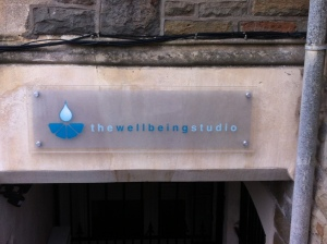 The Wellbeing Studio sign outside the building