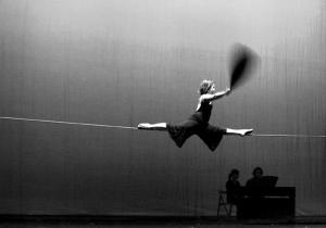 Tightrope walker on a slack wire