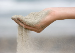 Sand passing through a hand