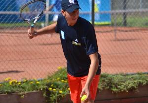Tennis player serving underarm