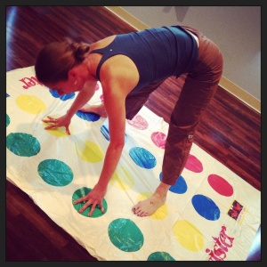 A yoga teacher playing Twister
