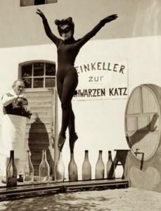 Catwoman balancing on bottles