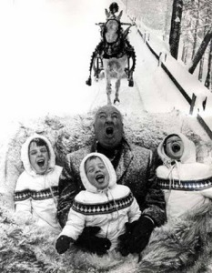 Hitchcock in a sleigh with children