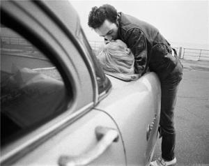 Joe Strummer on Car 1981 by Bob Gruen