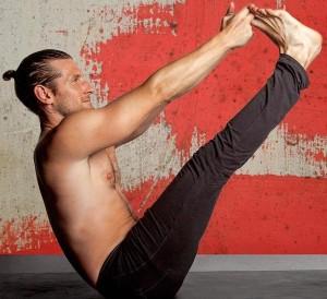 Man doing Pilates balance