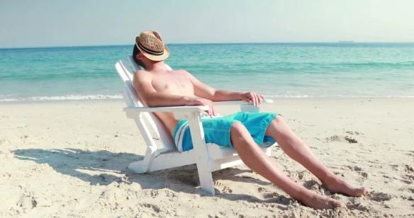 Man deckchair beach