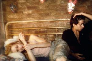 Greer and Robert on the bed, NYC 1982 by Nan Goldin